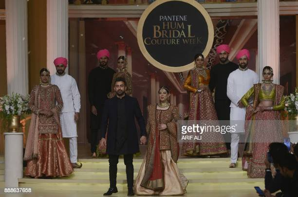 Pakistani Actor Shan and actress Uzma Hassan present a creation by Pakistani fashion designer Fahad Hussayn during the Pantene Hum Bridal Couture...