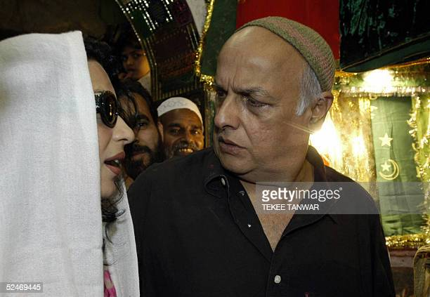 Pakistani actress Meera is accompanied by Indian film director Mahesh Bhatt as she visits the Sufi Shrine of Hazrat Nizamuddin in New Delhi 23 March...