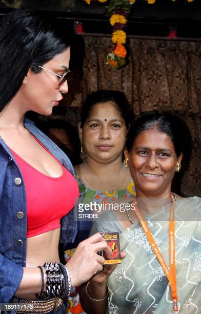 Pakistani actress Veena Malik visits Kamathipura Mumbai's oldest and Asia's 2nd largest red light district to promote their upcoming Hindi film...