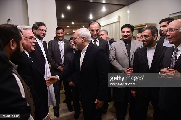 Pakistani adviser to the prime minister on foreign affairs Sartaj Aziz stands next to Iranian Foreign Minister Mohammad Javad Zarif greeting...