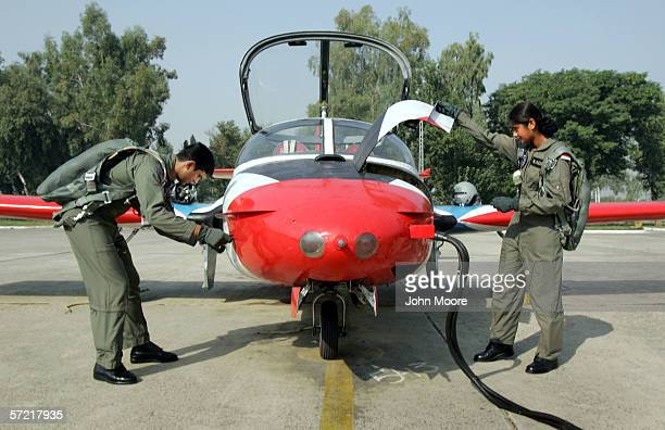 Pakistani Air Force cadet Nadia Gul checks her T37 training jet before a practice flight at the Pakistani Air Force Academy October 6 2005 in...