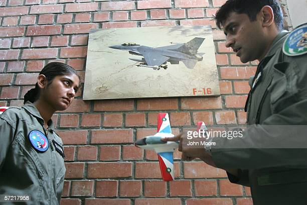Pakistani Air Force cadet Nadia Gul is critiqued by squadron leader Adnan Malik after flying a T37 training jet at the Pakistani Air Force Academy...