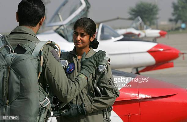 Pakistani Air Force cadet Nadia Gul listens to her instructor before flying a T37 training jet at the Pakistani Air Force Academy October 6 2005 in...
