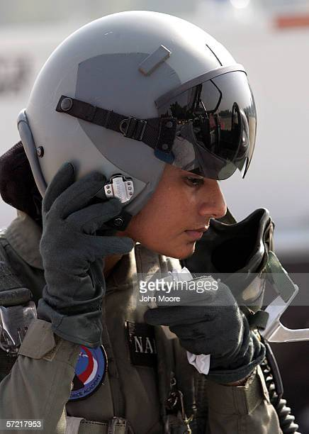 Pakistani Air Force cadet Nadia Gul removes her flight helmet after flying a T37 training jet at the Pakistani Air Force Academy October 6 2005 in...