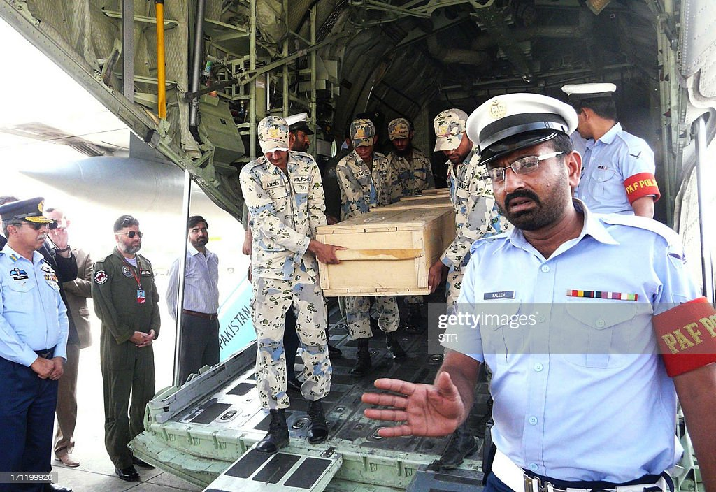 Pakistani air force personnel carry coffins of foreign tourists as they are unloaded from a C-130 air plane upon arrival at Chaklala airbase in Rawalpindi on June 23, 2013. Gunmen dressed as police killed nine Chinese and Ukrainian tourists in an unprecedented attack in the Pakistani Himalayas claimed by the Taliban, who said they had set up a new faction to target foreigners in revenge for US drone strikes.