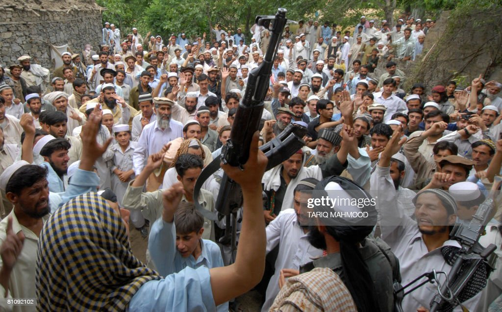 Pakistani alleged Taliban supporters chant anti-US slogans as they gather at the site of a US missile strike in Damadola village in the northwestern Bajaur tribal district which borders Afghanistan's volatile Kunar province, on May 15, 2008. Pakistani militants on May 15 accused the United States of carrying out a missile strike in the country's lawless tribal region and vowed to avenge the attack, which killed at least 12 people. AFP PHOTO/Tariq MAHMOOD
