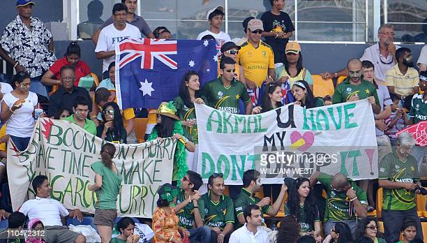 Pakistani and Australian cricket supporters wave banners before the start of the Australia versus Pakistan World Cup cricket match at The R Premadasa...