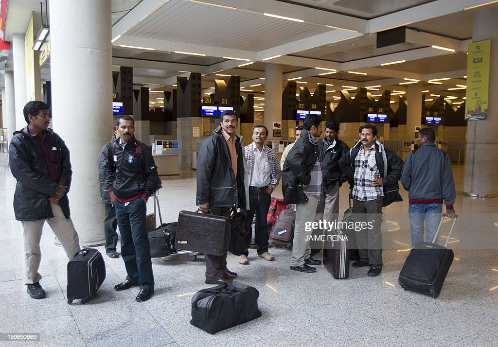 Pakistani and Indian employees of subcontracters working for British oil giant BP in Algeria wait for their flight back to Dubai at the Palma de Mallorca airport on January 18, 2013. Foreign workers leave Algeria following an Algerian army rescue operation launched at the In Amenas plant on January 17, 2013 after kidnappers seized hostages at the site in what they said was retaliation for Algeria's support for French air strikes in Mali.