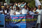 Pakistani and Kashmiri activists protest against the violence in Indianadministered Kashmir in Muzaffarabad the capital of Pakistanadministered...