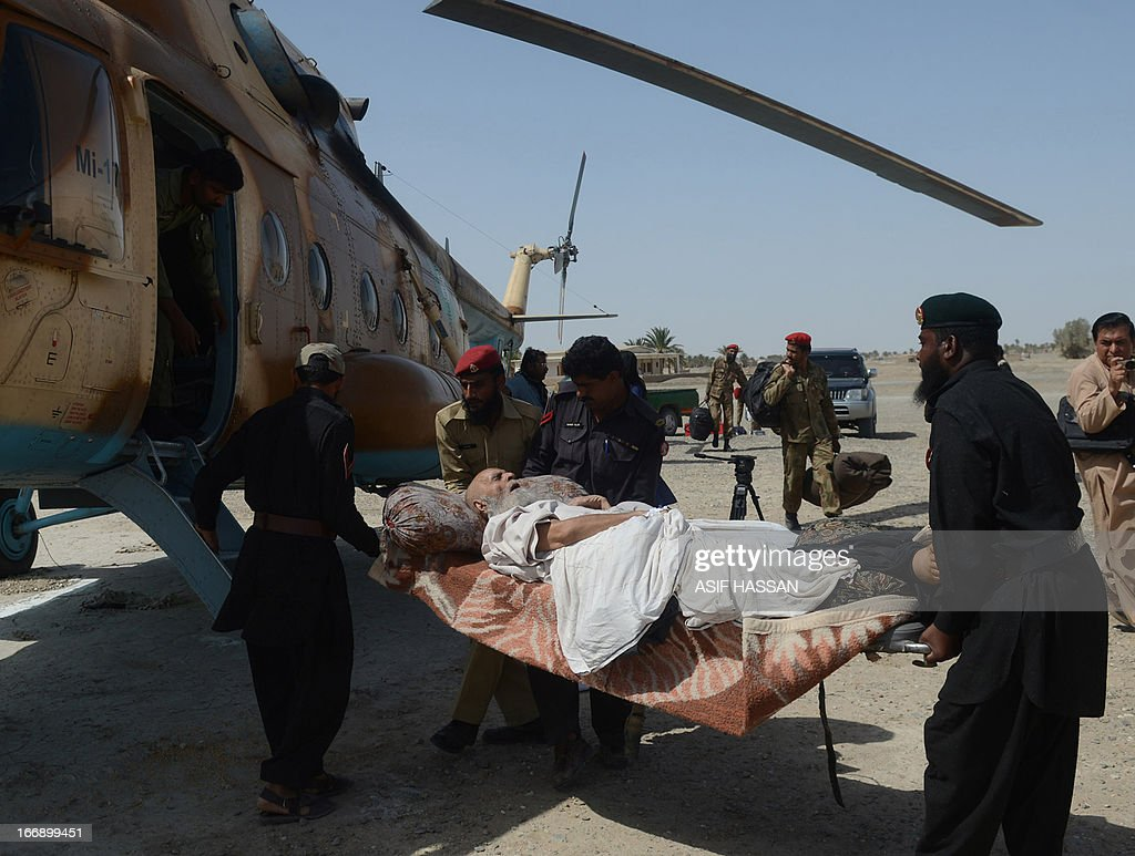 Pakistani Army and frontier soldiers transport an injured earthquake survivor to an Army helicopter in the quake hit Mashkail area of southwestern Baluchistan province on April 18, 2013. More than 12,000 Pakistanis living in a remote, impoverished southwestern desert region near the Iranian border have been affected by this week's huge earthquake, a relief official said.