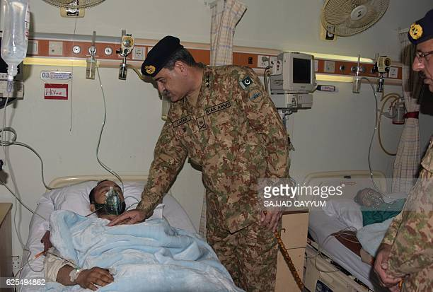 Pakistani army officer lieutenant general Zafar Iqbal Malik meets with an injured man from a passenger bus hit in crossborder shelling at a hospital...