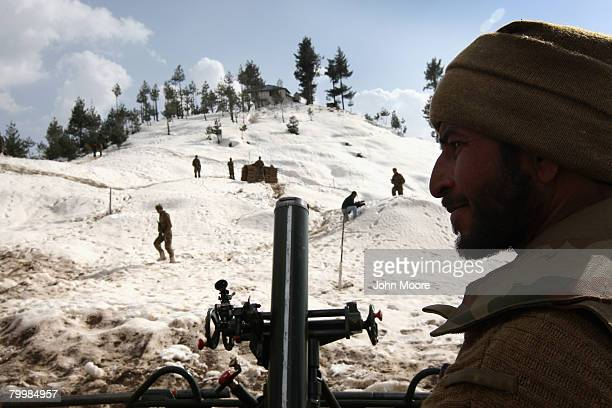 Pakistani Army soldier stands by a mortar tube on a strategic mountain top February 25 2008 in Shangla northwestern Pakistan The army has been...