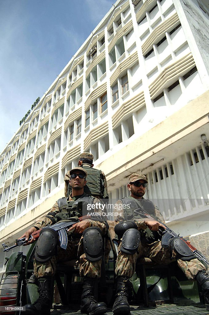 Pakistani army soldiers guard the state-run Printing Corporation of Pakistan, where electoral materials are prepared and loaded for distribution for the forthcoming parliamentary elections, in Islamabad on May 3, 2013. Pakistan will deploy more than 600,000 security personnel during next week's general election to guard against Taliban attacks that have marred campaigning. The May 11 polls will mark the first time that a civilian government has completed a full five-year term and handed over to an elected successor, in a country ruled by the military for half its 66-year history. AFP PHOTO/Aamir QURESHI