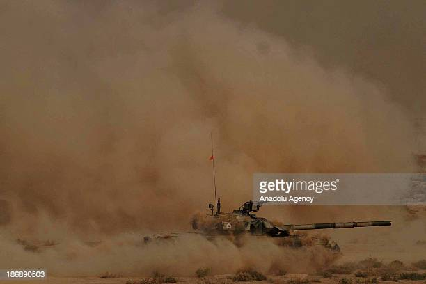 Pakistani Army soldiers show their skills during a military exercise named AzmeNau in Khairpur Tamaiwali on November 4 2013 in Bahawalpur Pakistan...