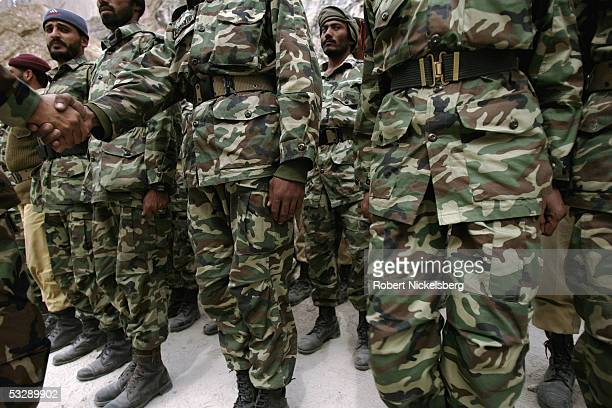 Pakistani Army soldiers stand at attention to meet their commanding officer during a training exercise near a battalion headquarters of the Pakistani...