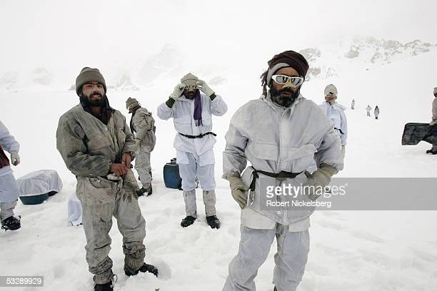 Pakistani Army soldiers walk above their military outpost on a spur of the Siachen Glacier at 18655 feet June 19 2005 in the Northern Territories of...