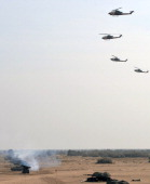 Pakistani army tanks and AH1 attack helicopters take part in the AzmeNau4' military exercise in Khairpure Tamay Wali in Bahawalpur district on...