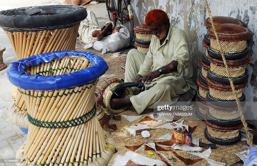 a pakistani artisan makes stools with straw by the roadside in karachi on july 20