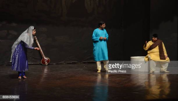 Pakistani artists performing during a stage play SUR on the occasion of World Theater Day organized by Alhamra Arts Council and Sufi Tabassum Arts...