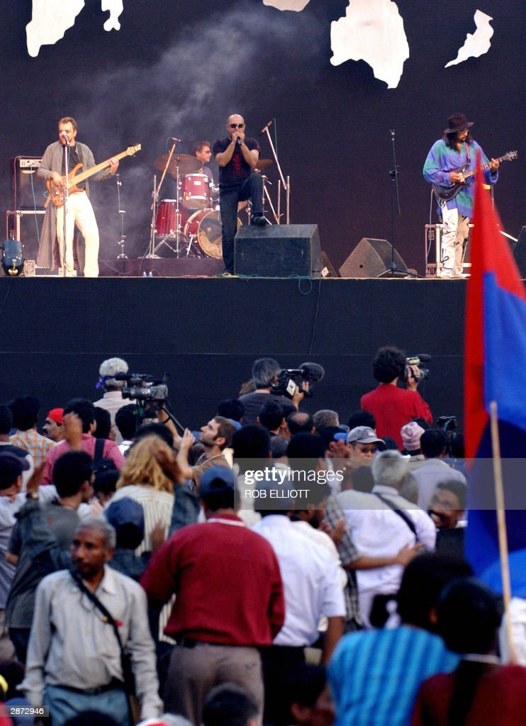Pakistani band Junoon play before a large audience at the opening of the World Social Forum in Bombay 16 January 2004 The World Social Forum will run...