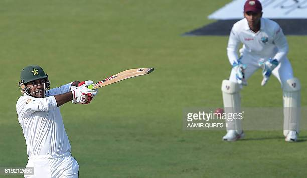 Pakistani bataman Sarfraz Ahmed hits a shot on the first day of the third and final Test between Pakistan and West Indies at the Sharjah Cricket...