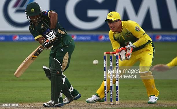 Pakistani batsman Asad Shafiq plays a shot during the second One Day International cricket match against Australia in Dubai on October 10 2014 AFP...