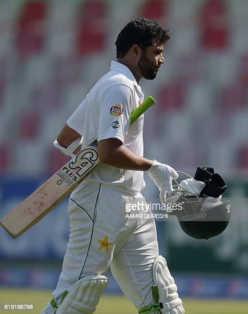 Pakistani batsman Azhar Ali leaves the ground after his dismissal for duck on the first day of the third and final Test between Pakistan and West...