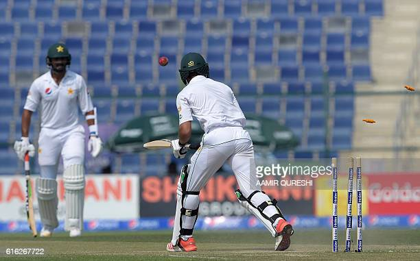 Pakistani batsman Mohammad Nawaz is bowled out by West Indies' cricket captain Jason Holder on the second day of the second Test between Pakistan and...