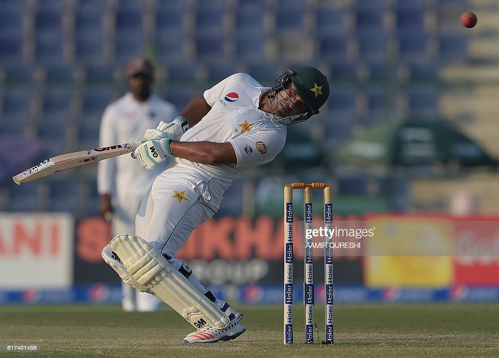 Pakistani batsman Sami Aslam avoids the bouncer on the third day of the second Test between Pakistan and the West Indies at the Sheikh Zayed Cricket Stadium in Abu Dhabi on October 23, 2016. Openers Azhar Ali and Sami Aslam hit half-centuries to help Pakistan strenghten their grip on the third day of the second Test against West Indies in Abu Dhabi. Ali was batting on 52 and Asad Shafiq five not out to take Pakistan to 114-1, having an overall lead of 342 after dismissing West Indies for 224 in their first innings. / AFP / AAMIR