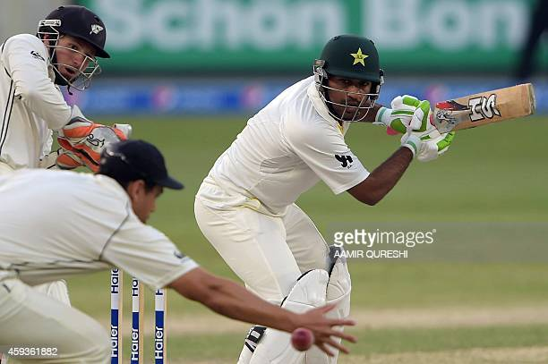 Pakistani batsman Sarfraz Ahmed plays a shot as New Zealand wicketkeeper BJ Watling looks on during the fifth and final day of the second Test match...