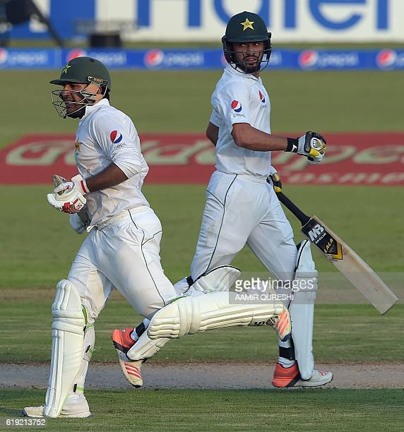 Pakistani batsmen Mohammad Nawaz and Sarfraz Ahmed run between the wicket on the first day of the third and final Test between Pakistan and West...