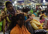Pakistani beauticians work with women and girls ahead of the Eid alFitr holiday which marks the end of Ramadan in Karachi on July 4 2016 Millions of...