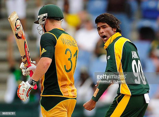 Pakistani bowler Mohammad Aamer celebrates after taking the wicket of Australian batsman David Warner during the ICC World Twenty20 second semifinal...