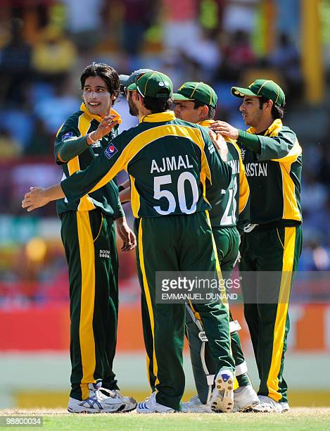 Pakistani bowler Mohammad Aamer celebrates with teammates after taking the wicket of Australian batsman Michael Hussey during the ICC World Twenty20...