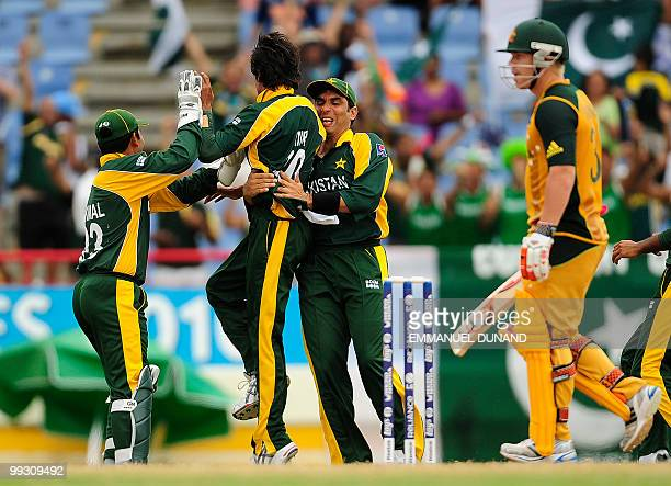 Pakistani bowler Mohammad Aamer celebrates with teammates after taking the wicket of Australian batsman David Warner during the ICC World Twenty20...