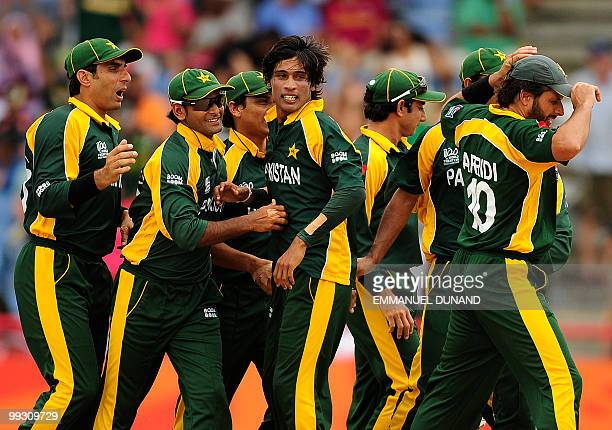 Pakistani bowler Mohammad Aamer celebrates with teammates after taking the wicket of Australian batsman Shane Watson during the ICC World Twenty20...