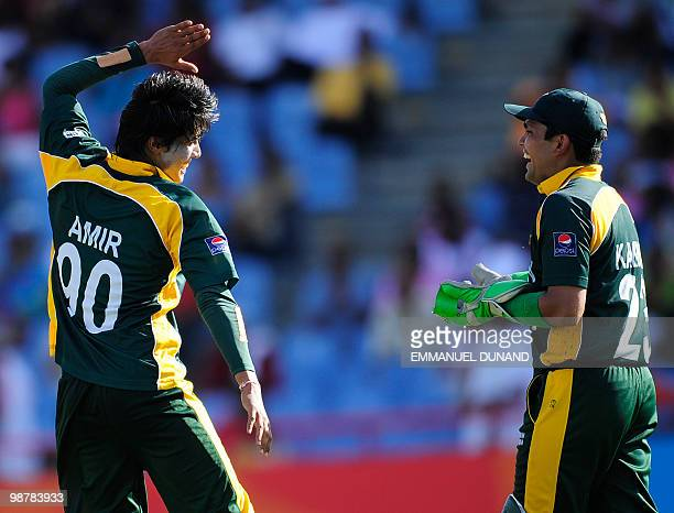 Pakistani bowler Mohammad Aamer celebrates with wicketkeeper Kamran Akmal after catching behing Bangladeshi batsman Mohammad Ashraful during the...