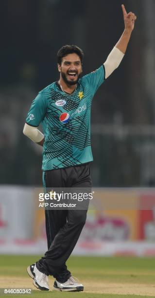 Pakistani bowler Rumman Raees celebrates after taking the wicket of World XI batsman Tamim Iqbal during the first Twenty20 international cricket...