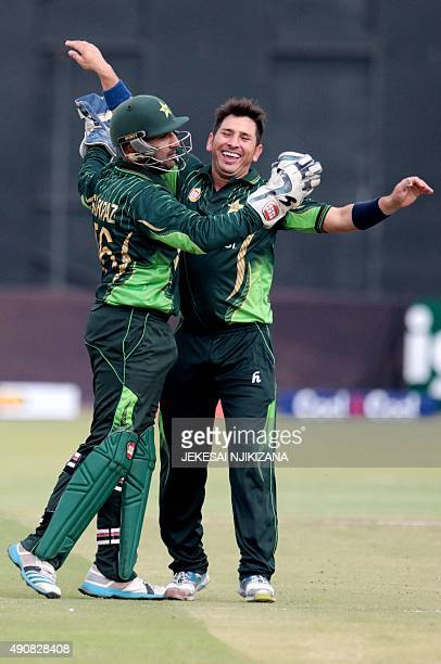 Pakistani bowler Yasir Shah celebrates a wicket with wicketkeeper Sarfraz Ahmed during the first in a series of three One Day International cricket...