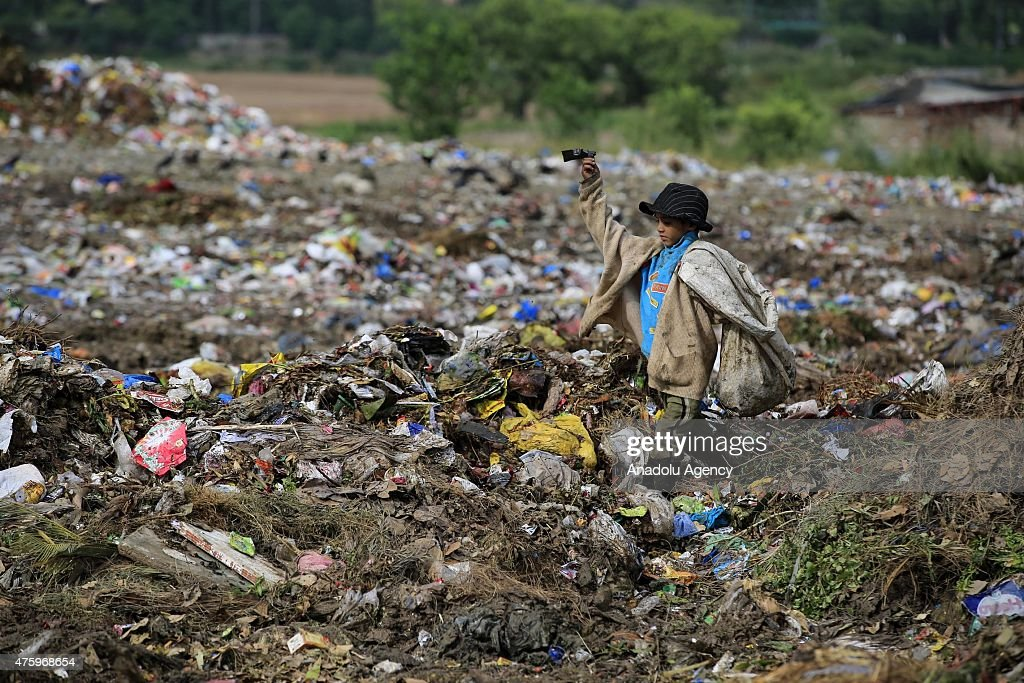 A Pakistani boy collects usable material from a dump site on the World Environment Day in Islamabad, Pakistan on June 5, 2015. World Environment Day (WED) is celebrated every year on 5 June to raise global awareness to take positive environmental action to protect nature and the planet Earth.
