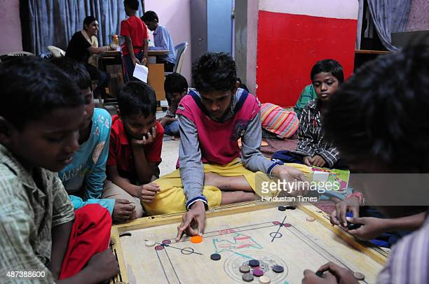 Pakistani boy Mohammad Ramzan playing carrom with inmates of shelter home run by NGO Ummeed on September 7 2015 in Bhopal India Mohd Ramzan was...