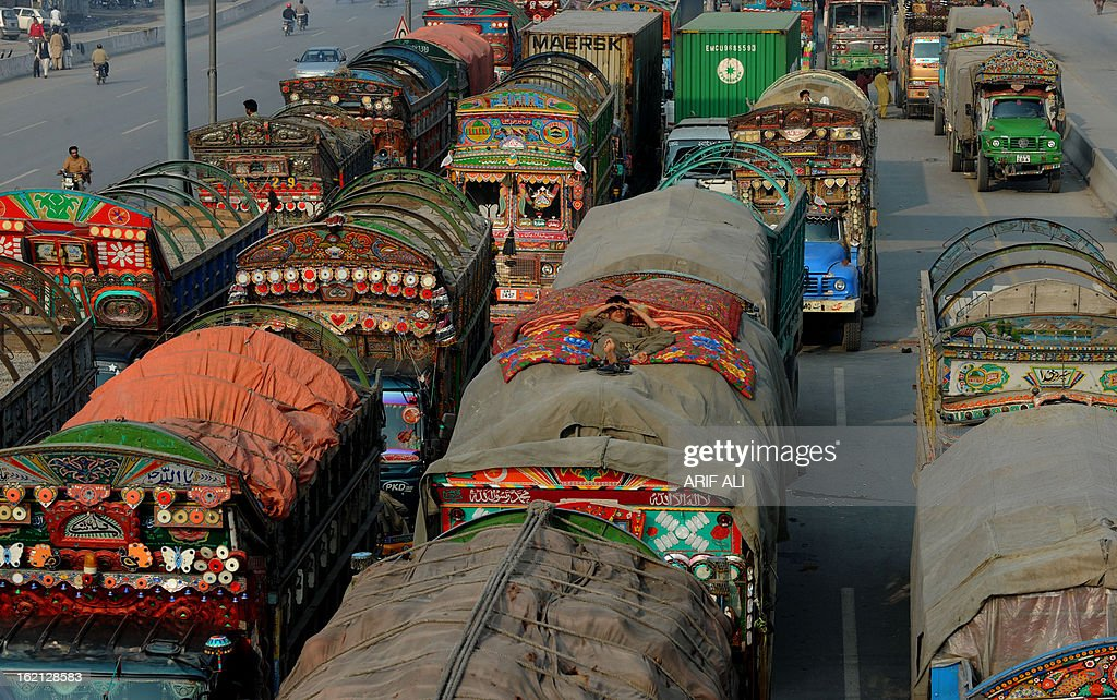 A Pakistani boy rests on a parked truck during a protest against the Quetta bombing, in Lahore on February 19, 2013. Thousands of Pakistani Shiite Muslims called off nationwide protests Tuesday and agreed to bury the dead from a bomb attack that killed 89 people, after the government promised to arrest those responsible. AFP PHOTO/Arif ALI