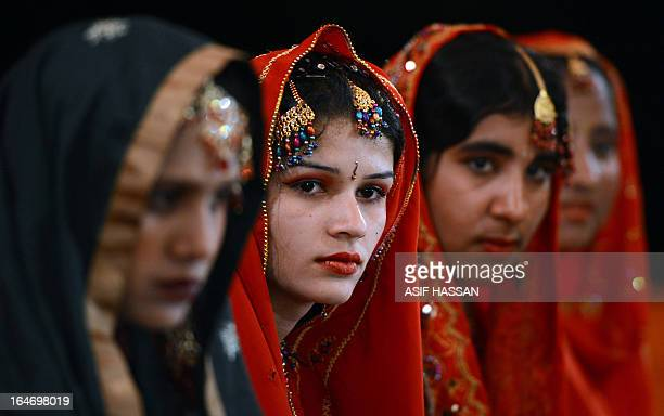 Pakistani brides attend a mass marriage ceremony in Karachi late March 26 2013 Some 110 couples participated in the mass wedding ceremony organised...