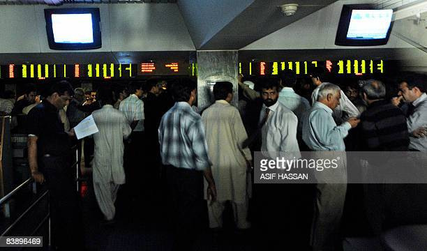 Pakistani brokers are busy in offmarket trading of shares at the stock exchange in Karachi on December 3 2008 Dozens of members of the country's...