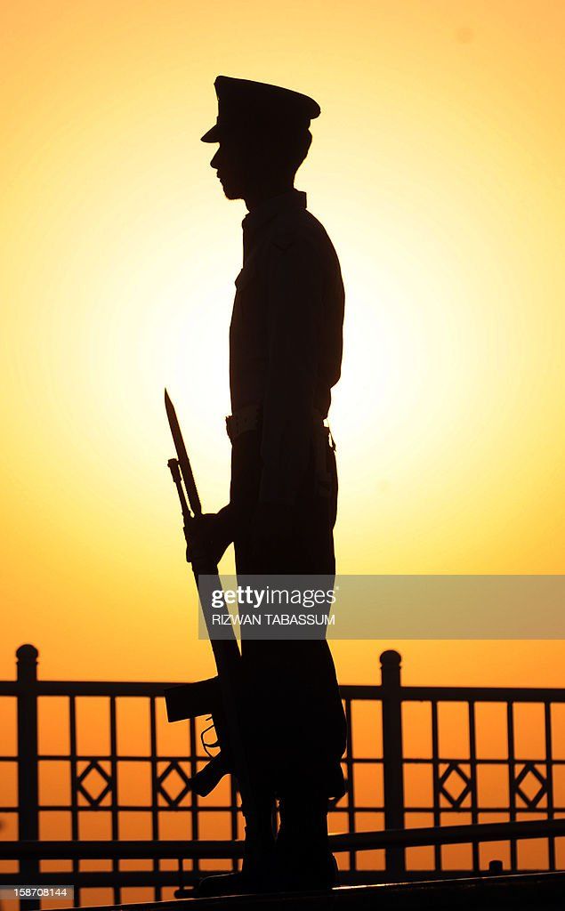 A Pakistani cadet stands guard during a ceremony on the 136th birth anniversary of Pakistan's founder Mohammad Ali Jinnah at his mausoleum in Karachi on December 25, 2012. Special ceremonies were held at the mausoleum in the port city and other parts of the country to celebrate the 136th birth anniversary of Jinnah.