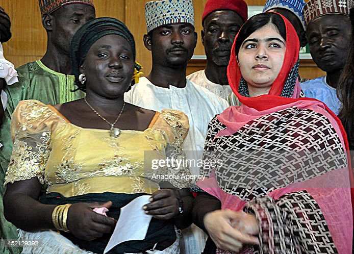 Pakistani campaigner for education right <a gi-track='captionPersonalityLinkClicked' href=/galleries/search?phrase=Malala+Yousafzai&family=editorial&specificpeople=5849423 ng-click='$event.stopPropagation()'>Malala Yousafzai</a> (R) meets with the families of the Nigerian schoolgirls abducted by Boko Haram militants in Abuja, Nigeria on July 13, 2014. <a gi-track='captionPersonalityLinkClicked' href=/galleries/search?phrase=Malala+Yousafzai&family=editorial&specificpeople=5849423 ng-click='$event.stopPropagation()'>Malala Yousafzai</a>, Pakistani schoolgirl shot in the head by the Taliban in October 2012 for campaigning for better rights for girls.