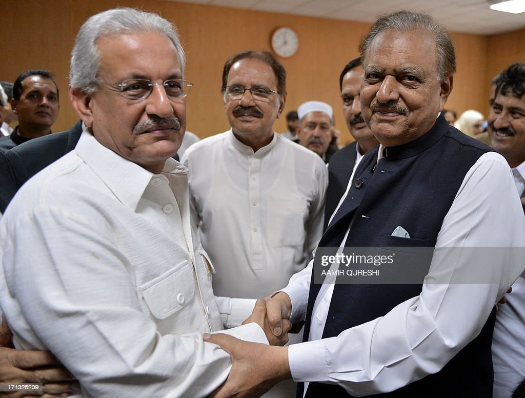 Pakistani candidate for the upcoming presidential election, Mamnoon Hussain (R) of the ruling Pakistan Muslim League-N (PMLN) and candidate Senator Raza Rabbani (L) of the opposition Pakistan Peoples Party (PPP) shake hands after submitting their nomination papers at the High Court in Islamabad on July 24, 2013. Pakistan's Supreme Court on July 24 revised the date for the presidential election, asking the election commission to hold it on July 30 instead of August 6. The court made the order as many of the lawmakers who will elect a replacement for President Asif Ali Zardari will be paying pilgrimages or offering special prayers on August 6 for the Islamic holy month of Ramadan, which ends a few days later. AFP PHOTO /AAMIR QURESHI