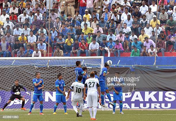 Pakistani captain Kaleem Ullah looks on as he takes a free kick to score Pakistan's first goalagainst India during their second friendly football...