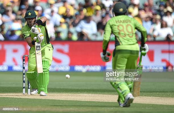 Pakistani captain Misbahul Haq plays a shot as batsman Haris Sohail looks on during the 2015 Cricket World Cup quarterfinal match between Australia...