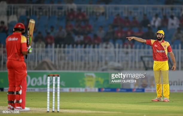 Pakistani captain MisbahulHaq of Islamabad United adjusts the field during an exhibition match at Rawalpindi Cricket stadium in Rawalpindi on...